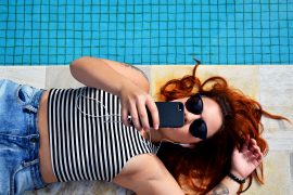 woman pool phone