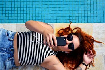 woman pool phone